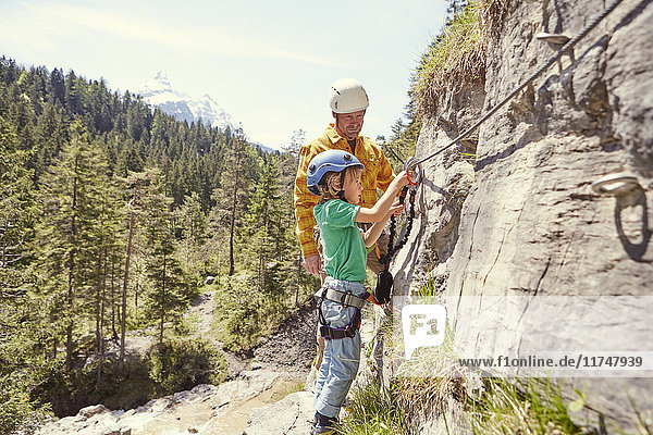 Father and child rock climbing  Ehrwald  Tyrol  Austria