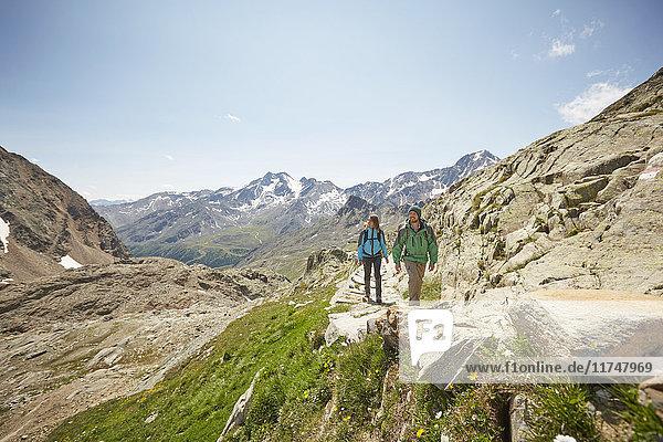 Young couple hiking at Val Senales Glacier  Val Senales  South Tyrol  Italy