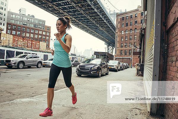 Young female runner running  New York  USA