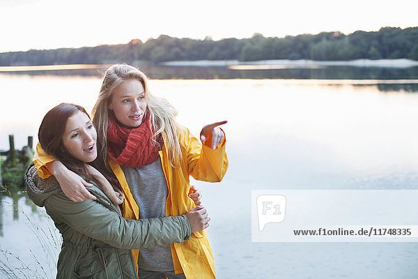 Young women enjoying scenery by lake