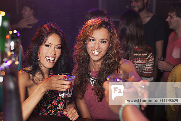 Women toasting in club