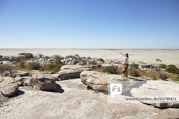 Mother and son on rock  Kubu Island  Makgadikgadi Pan  Botswana  Africa