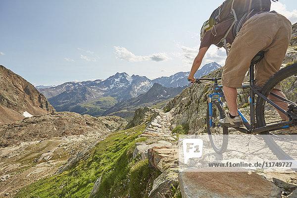 Young man mountain biking at Val Senales Glacier  Val Senales  South Tyrol  Italy
