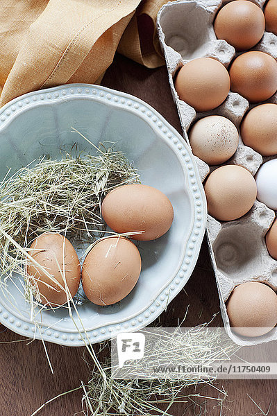 Fresh eggs and straw