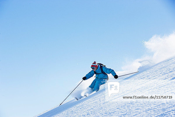 Male skiing downhill