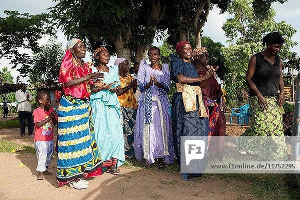Ugandan ladies performing a welcome dance for visitors. Uganda. (Photo by: Wayne Hutchinson/Farm Images/UIG)