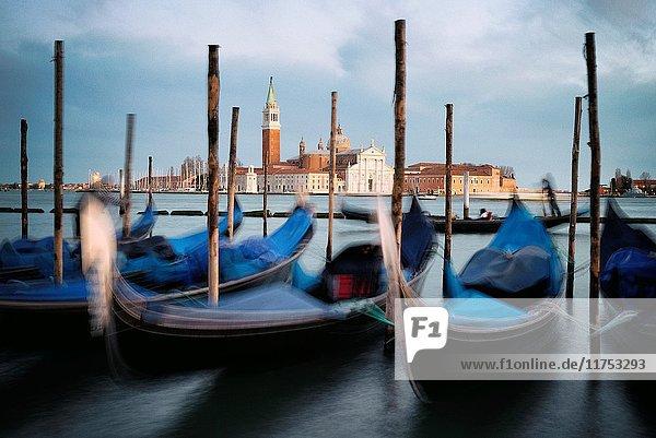 Italy  Veneto  Venice  listed as World Heritage by UNESCO  Saint Mark's Square (Piazza San Marco)  gondolas at Riva degli Schiavoni docks  the basilica and monastery of San Giorgio Maggiore in the background
