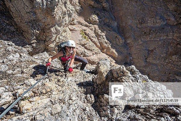 Sesto/Sexten  Dolomites  South Tyrol  province of Bolzano  Italy. Climber on the via ferrata De Luca-Innerkofler to the summit of Monte Paterno.