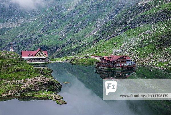 View of Balea Lake next to Transfagarasan Road in Fagaras Mountains (part of Carpathian Mountains)  Romania.