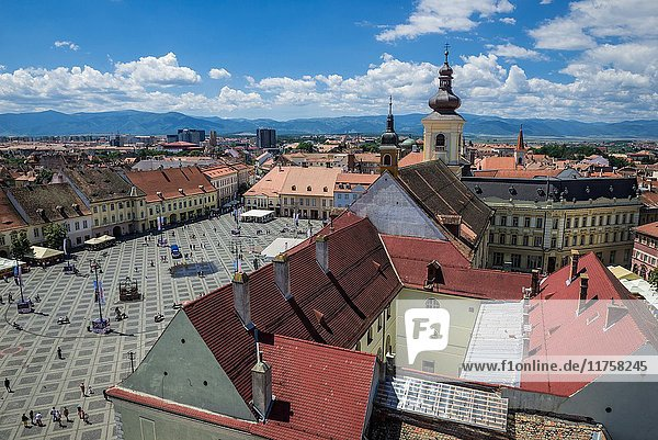 Aerial view from Council Tower on a historical buildings on Large Square of Historic Center of Sibiu city  Romania. Holy Trinity Church on photo.