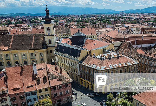 Aerial view with Holy Trinity Church and City Hall from Lutheran Cathedral of Saint Mary in Historic Center of Sibiu city of Transylvania  Romania.