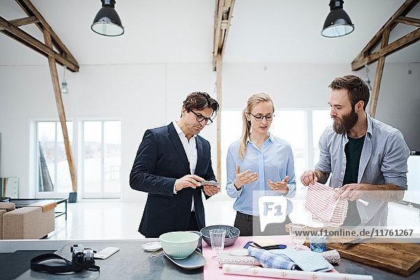Interior designer team looking at kitchenware in design studio