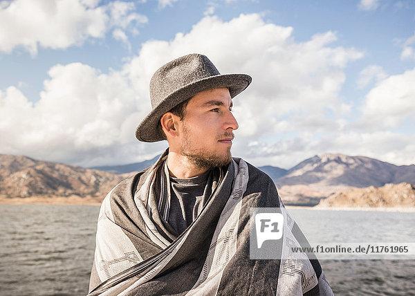 Man wrapped in blanket at Lake Isabella  California  USA