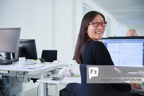 Woman working in office  using computer