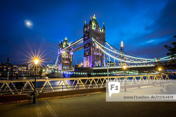 A moonlit evening in London with a view of Tower Bridge and the Shard behind  London  England  United Kingdom  Europe