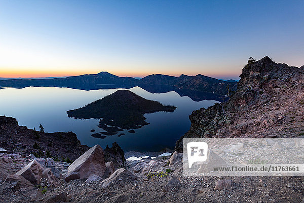 Wizard Island and the still waters of Crater Lake at dawn  the deepest lake in the U.S.A.  part of the Cascade Range  Oregon  United States of America  North America