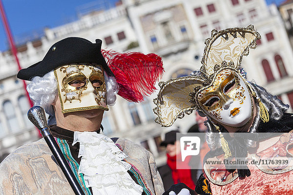Colourful masks and costumes of the Carnival of Venice  famous festival worldwide  Venice  Veneto  Italy  Europe