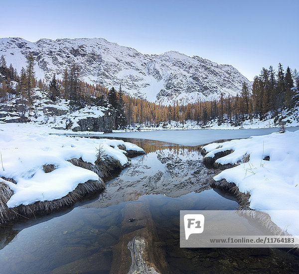 The snowy peaks reflected in the frozen Lake Mufule  Malenco Valley  Province of Sondrio  Valtellina  Lombardy  Italy  Europe