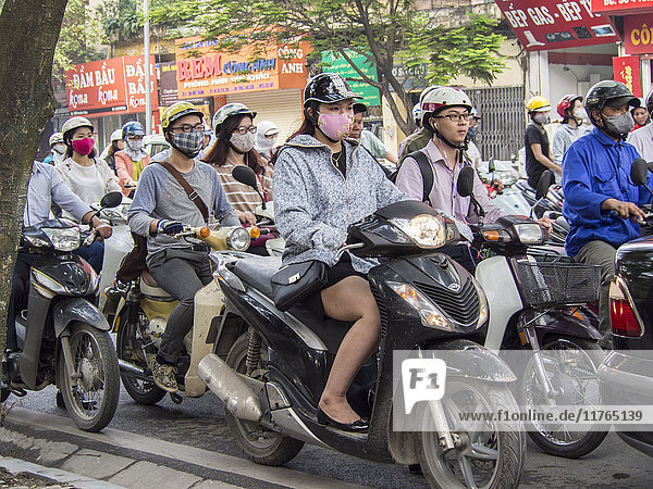Motorbike traffic and facemasks  Hanoi  Vietnam  Indochina  Southeast Asia  Asia