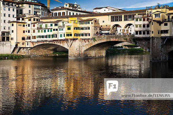 Ponte Vecchio reflected in the Arno River  Florence  UNESCO World Heritage Site  Tuscany  Italy  Europe