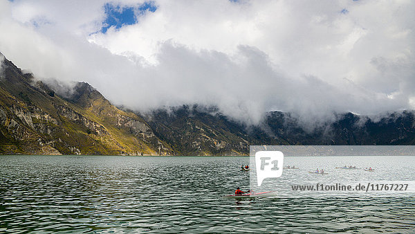 Kayaks at Quilotoa  a water-filled caldera and the most western volcano in the Ecuadorian Andes  Ecuador  South America