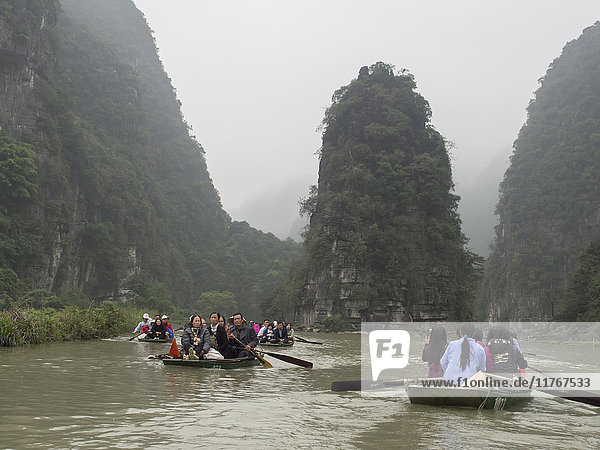 Tourist rowboats on the river  Tam Coc  Vietnam  Indochina  Southeast Asia  Asia