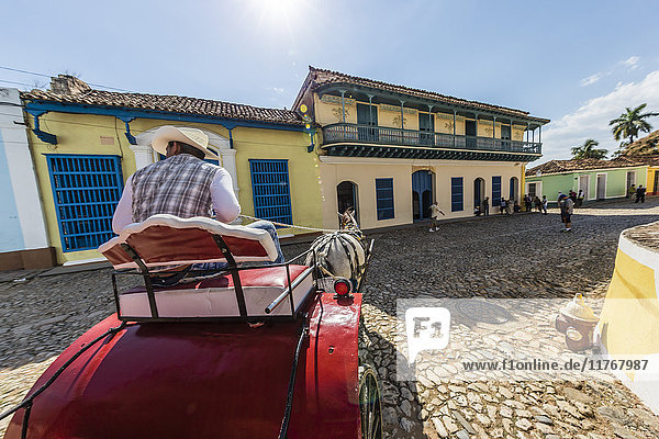 A horse-drawn cart known locally as a coche in Plaza Mayor  Trinidad  UNESCO World Heritage Site  Cuba  West Indies  Caribbean  Central America