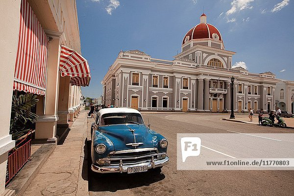 Old American car parked at the roadside near Palacio del Gobierno-Goverment House  Cienfuegos  Cuba  West Indies  Central America