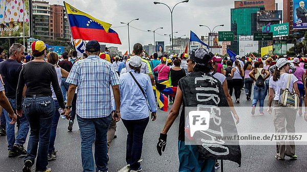 CARACAS  VENEZUELA - APRIL 6: Venezuelan opposition activists clashes wiht Police in Caracas on April 6  2017. The center-right opposition vowed fresh street protests -after earlier unrest left dozens of people injured - to increase pressure on Maduro  whom they blame for the country's economic crisis.