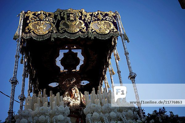 An image of Nuestra Señora de las Lágrimas (Our Lady of Tears) is displayed under a pallium during Easter Week celebrations in Baeza  Jaen Province  Andalusia  Spain.