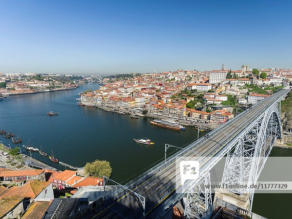 View from Vila Nova de Gaia towards Porto with the old town and the bridge Ponte Dom Luis I. City Porto (Oporto) at Rio Douro in the north of Portugal. The old town is listed as UNESCO world heritage. Europe  southern Europe  Portugal  April.