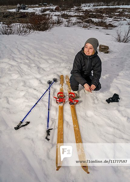 Woman with Cross Country Skis  Lapland  Sweden.