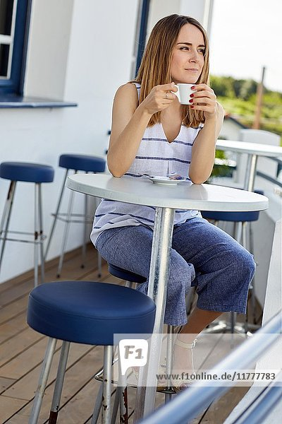 Young girl having coffee  Guethary  Aquitaine  Pyrenees Atlantiques  Basque Country  France  Europe