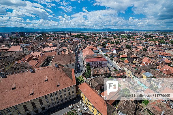 Aerial view on Huat Square from Cathedral of Saint Mary in Historic Center of Sibiu  Romania. Samuel von Brukenthal National College on foreground.