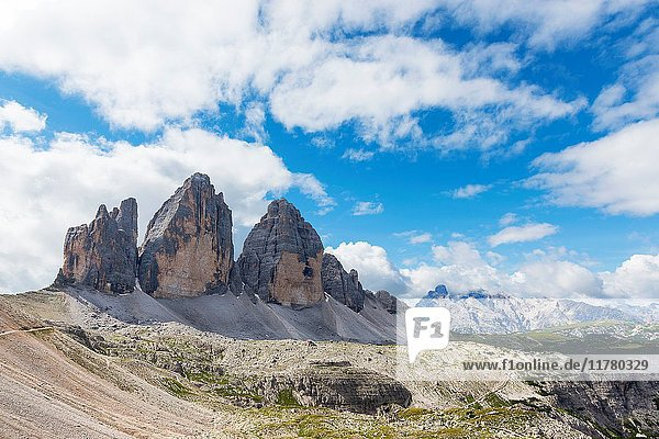 View of the Three Peaks of Lavaredo on a cloud day. Sesto Dolomites Trentino Alto Adige Italy Europe.