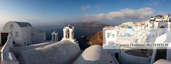 The white of the church and of houses and the blue of Aegean Sea as symbols of Greece Oia Santorini Cyclades Greece Europe.