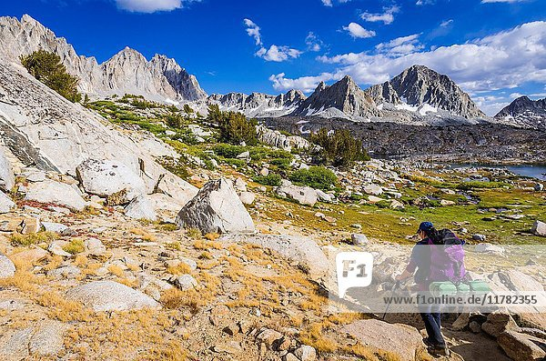 Backpacker on the Bishop Pass trail in Dusy Basin  Kings Canyon National Park  California USA.