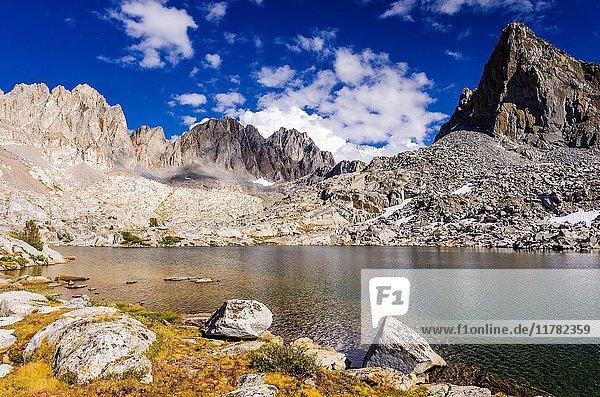 The Palisades above lake in Dusy Basin  Kings Canyon National Park  California USA.