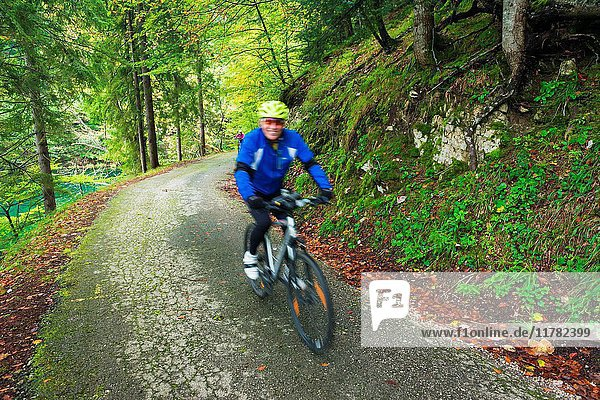Cyclists exploring the backroads and mixed forest of Plitvice Lakes National Park  Croatia.