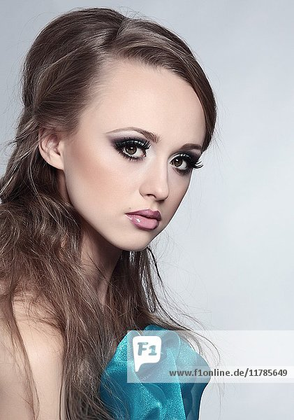 Young woman with creative make-up.