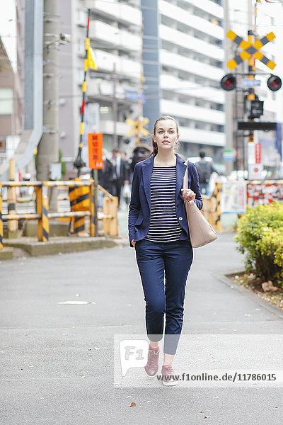 Caucasian woman downtown Tokyo  Japan