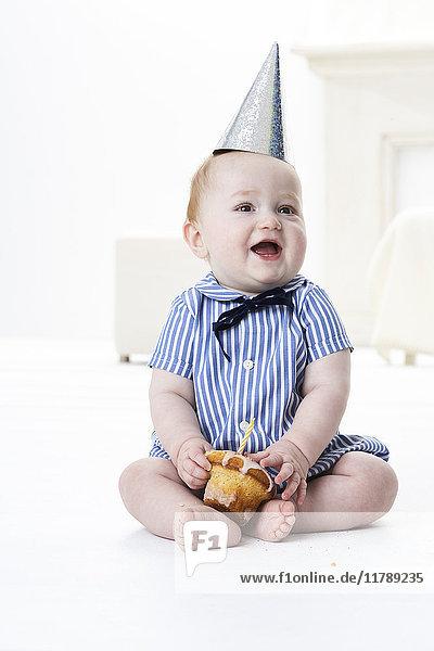 Portrait of baby boy with birthday cake