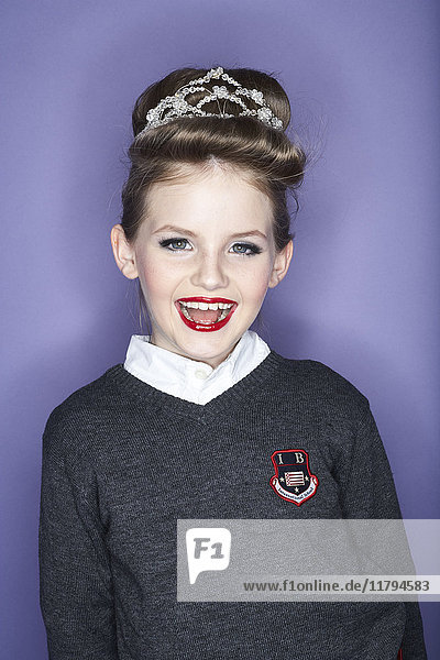Portrait of laughing girl with red lips wearing hair decoration