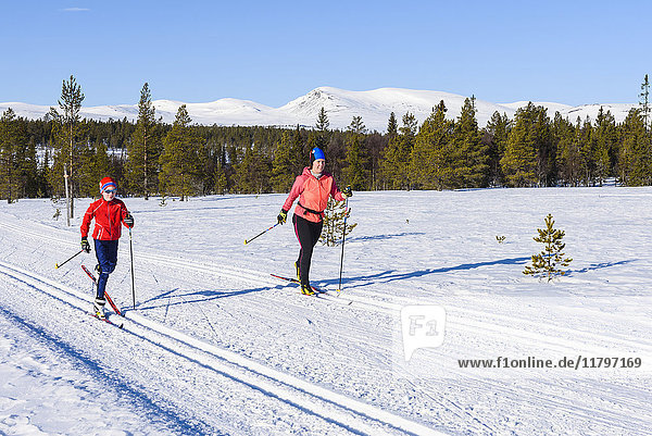 Mother and son cross-country skiing