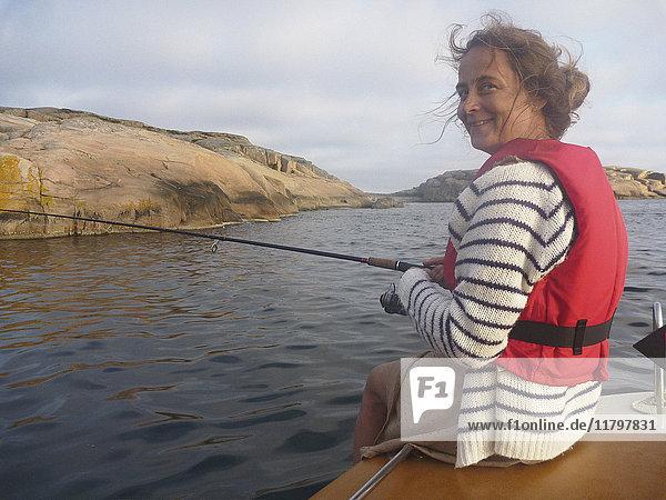 Smiling woman fishing