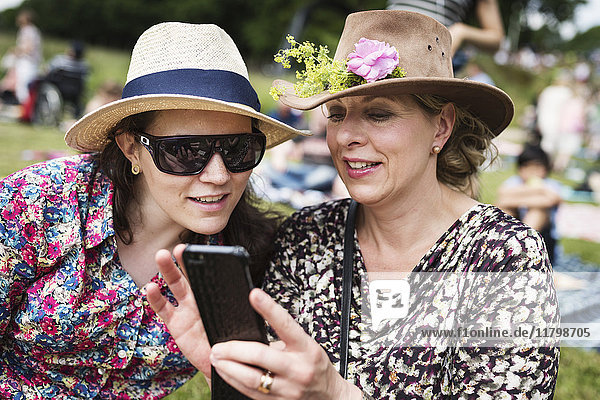 Women looking at cell phone