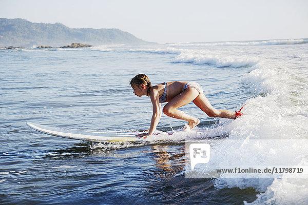 Girl surfboarding