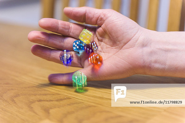 Hand throwing dices