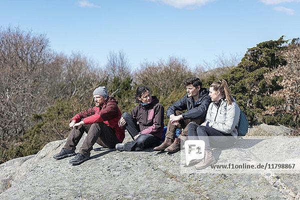 Friends sitting on rock