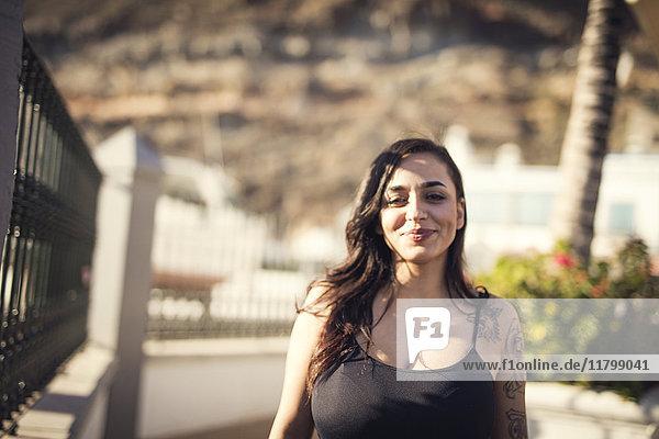 Portrait of tattooed woman